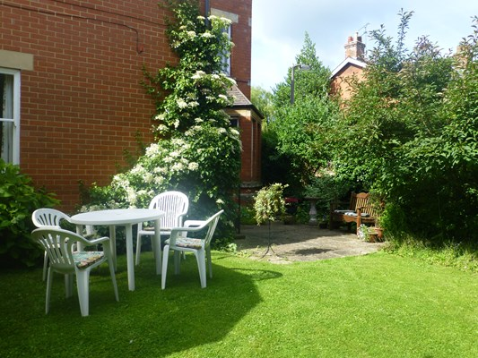 The lawn and patio at Abbeyfield House