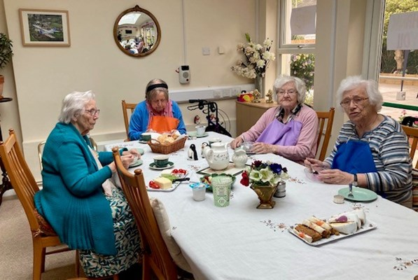 Our residents enjoying cake and tea together